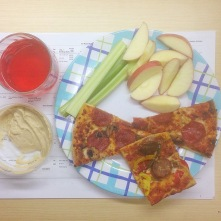 Pizza, fruit/veg, hummus, kombucha.